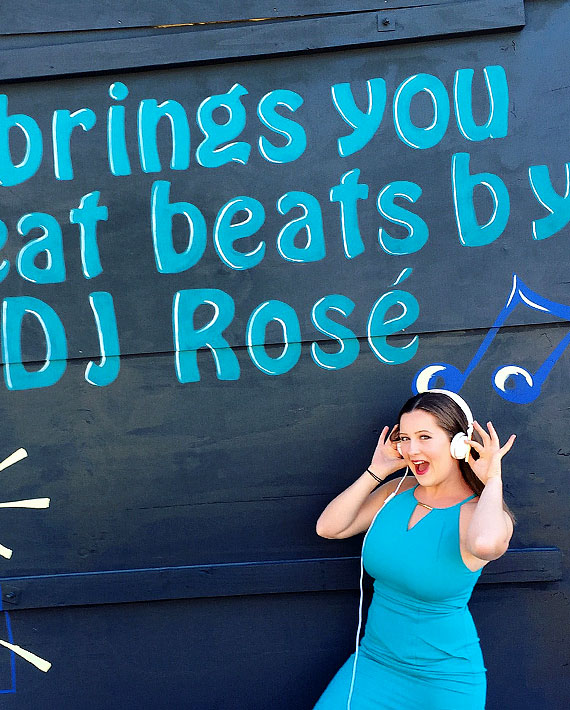 Queenstown Event DJ from LA Social in girl DJ wearing blue and headphone at corporate event