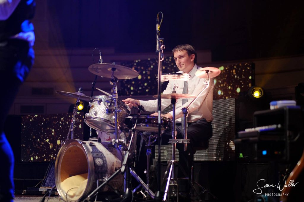 Queenstown Band member playing drums at corporate event