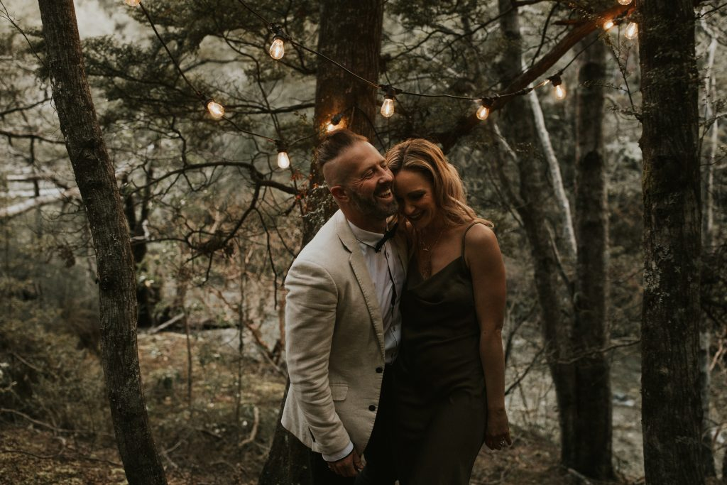 Rustic wedding singers from Queenstown Wedding Band LA Social in the native New Zealand forest for wedding inspo