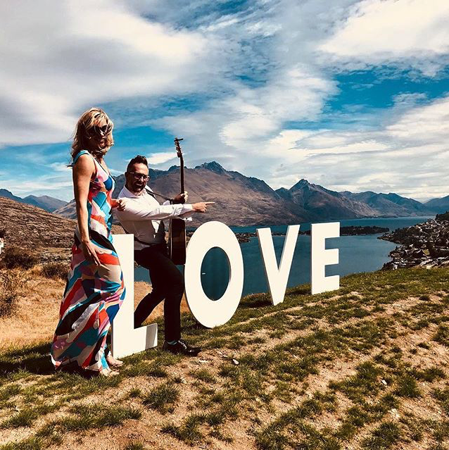 2 Wedding Musicians from Queenstown Wedding Band LA Social with LOVE sign
