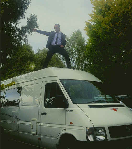 Queenstown Band performer standing on top of LT35 Van